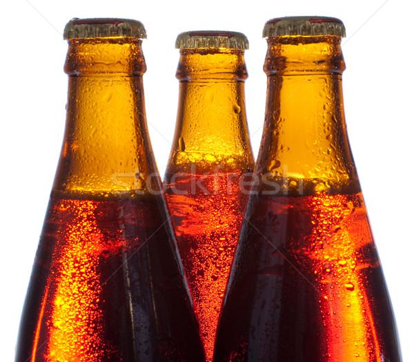 âmbar cerveja três garrafas isolado branco Foto stock © timbrk