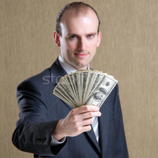 бизнесмен человека долларов стороны бизнеса Сток-фото © timbrk