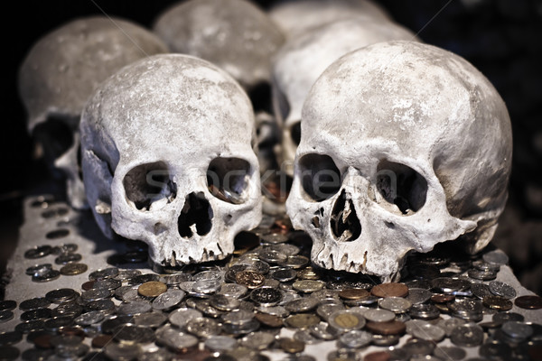 Skulls and coins Stock photo © timbrk