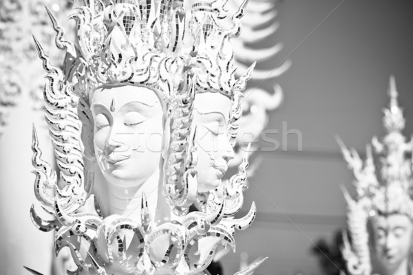 Mythological head in Wat Rong Khun Stock photo © timbrk