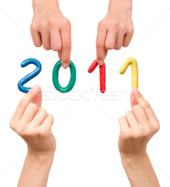 Nouvelle année 2011 mains main fond Photo stock © timbrk
