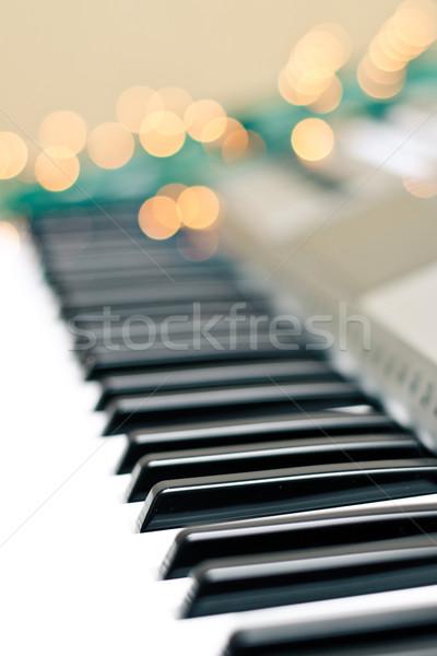 Synthesizer keyboard bokeh lights Stock photo © timbrk