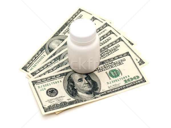 Vial and money Stock photo © timbrk