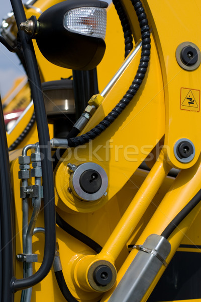 Digger's hydraulic hoses Stock photo © timbrk