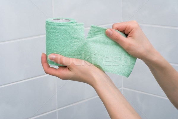 Toilet paper tearing Stock photo © timbrk