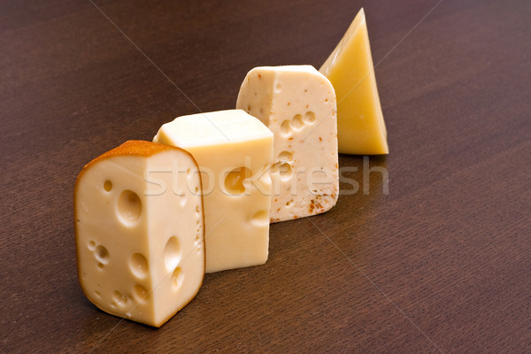 Row of cheeses Stock photo © timbrk