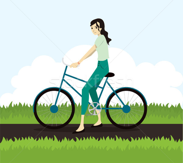 Active young woman riding on bicycle Stock photo © tina7shin