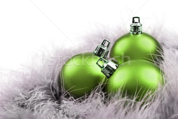Green christmas baubles in feathers Stock photo © tish1