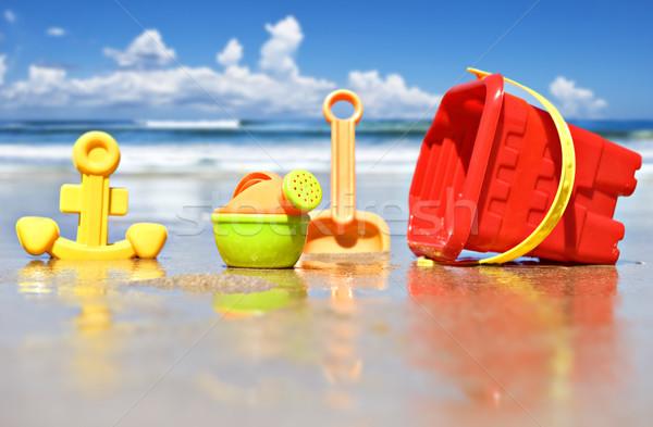 Praia brinquedos foco regador céu Foto stock © tish1