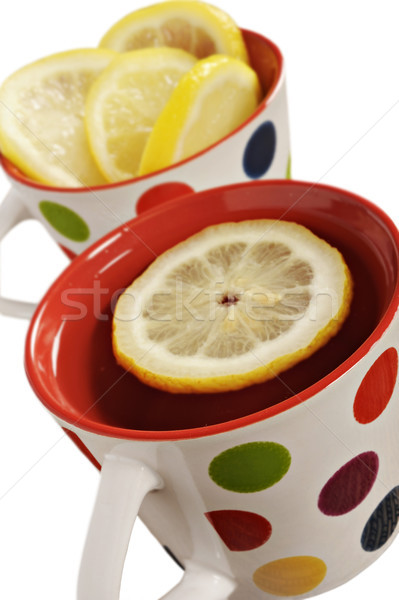 Healthy herbal tea with lemon in polka dot cups  Stock photo © tish1