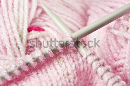 Knitting a pink baby jersey - yarn and needles Stock photo © tish1