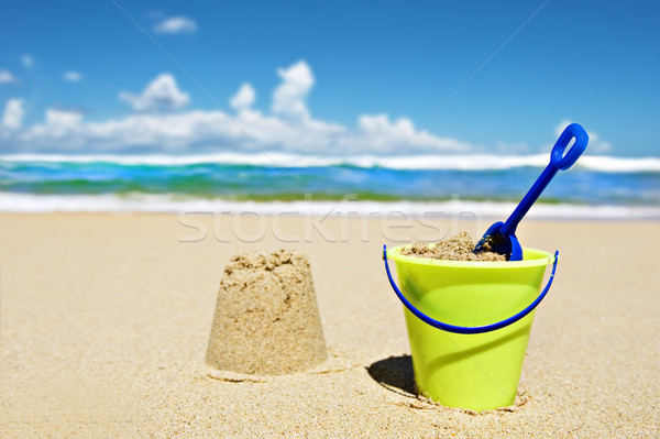 Toy bucket and shovel on the beach Stock photo © tish1