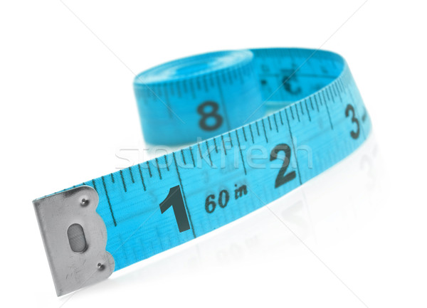 Tape measure on a white background with space for text Stock photo © tish1