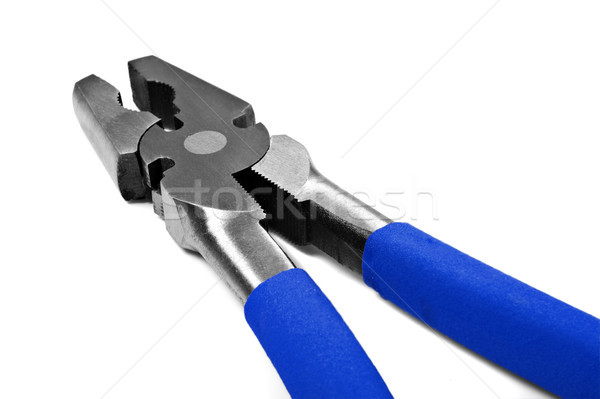 Close up macro of metal pliers with blue handle Stock photo © tish1