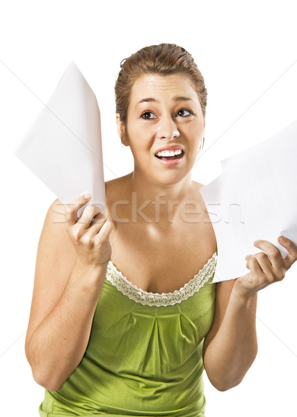 Beautiful young woman being discouraged by a overload of work - on a white background with space for Stock photo © tish1