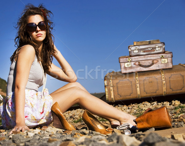 Young traveling woman with her suitcases along the road Stock photo © tish1