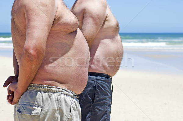 Iki şişman yağ erkekler plaj adam Stok fotoğraf © tish1