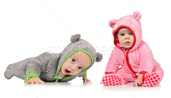 Six month old twin brother and sister on white Stock photo © tish1