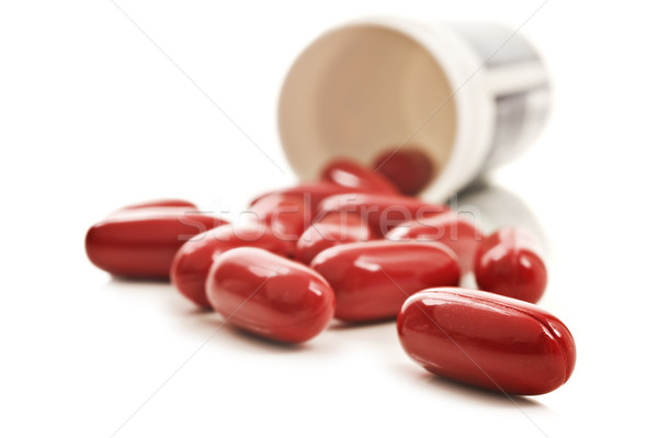 Red pills an pill bottle on white background Stock photo © tish1
