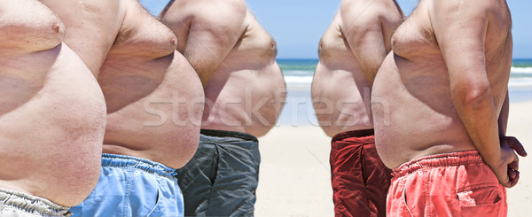 Five very obese fat men on the beach Stock photo © tish1