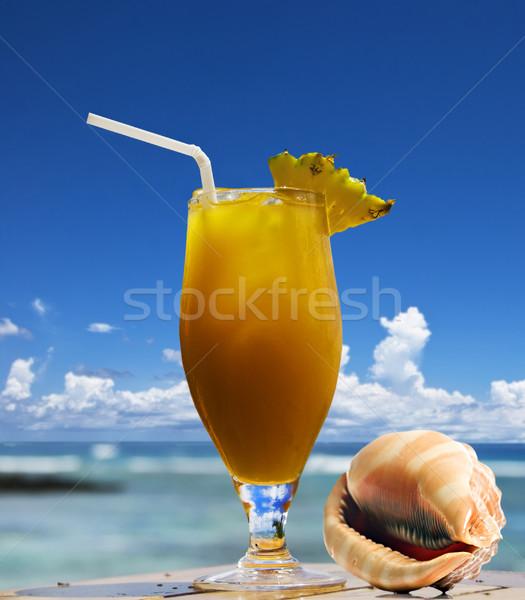 Tropische vruchten cocktail zee shell oceaan water Stockfoto © tish1