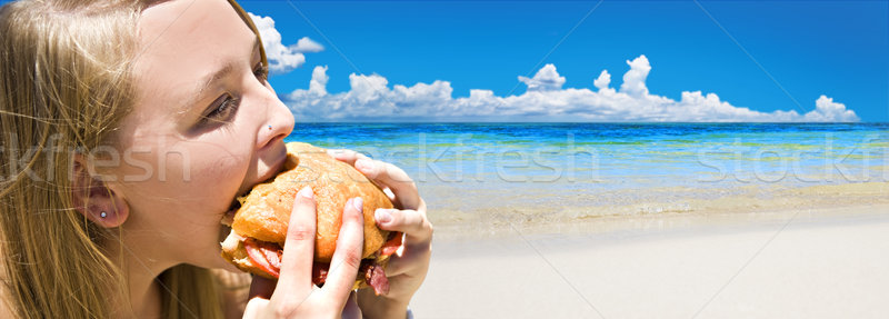 Tropical beach with young woman eating Stock photo © tish1