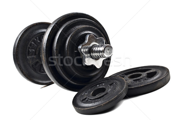Black dumbbells and loose weights on a white background with space for text Stock photo © tish1