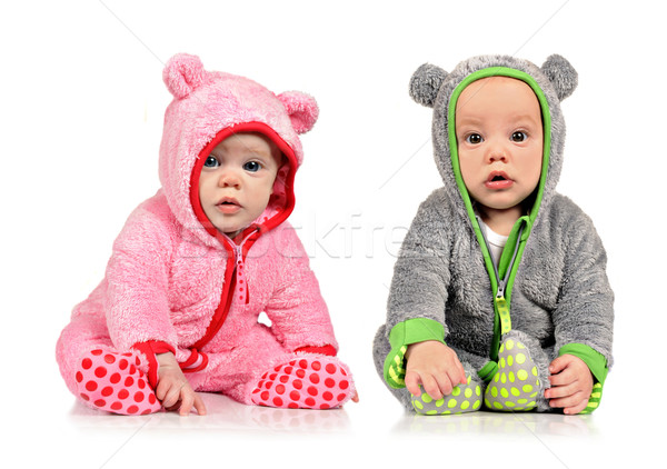 Six month old twin brother and sister on white background Stock photo © tish1