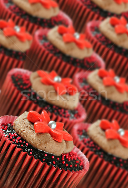 Chocolate cupcakes in red cups Stock photo © tish1