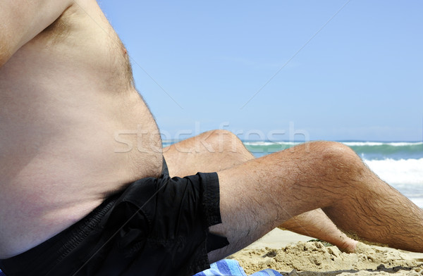 Unhealthy fat man sitting on the beach Stock photo © tish1