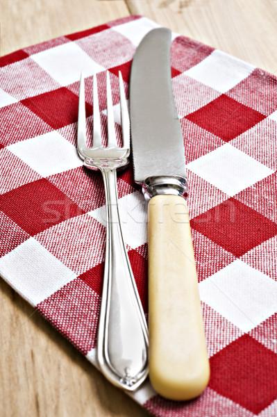 Antika bıçak çatal kırmızı beyaz bez Stok fotoğraf © tish1