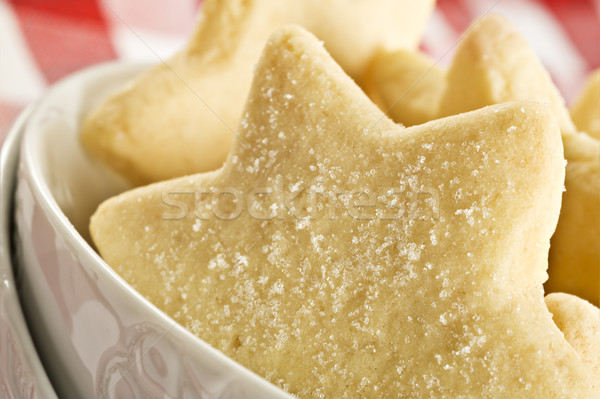Sugar coated shortbread cookies in star shapes stacked up - on a white background with space for tex Stock photo © tish1