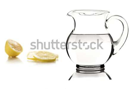Glass jug and tumbler with water on white Stock photo © tish1