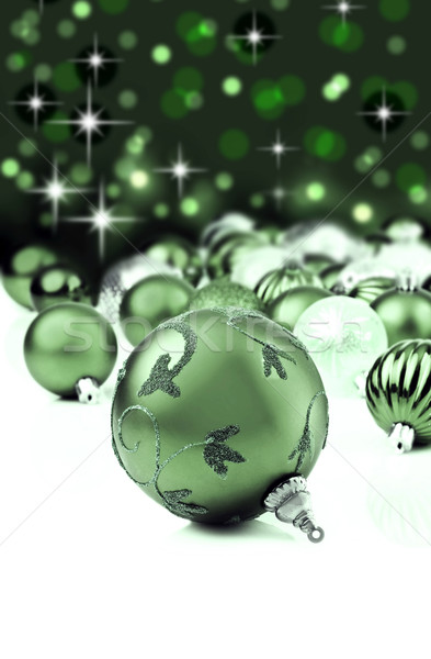 Green christmas ornaments with star background Stock photo © tish1