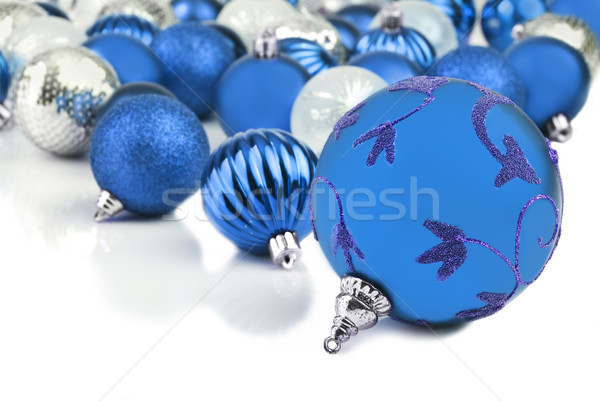 Blue christmas ornament baubles on white Stock photo © tish1