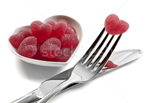 Red heart shaped jelly sweets with knife and fork on white Stock photo © tish1