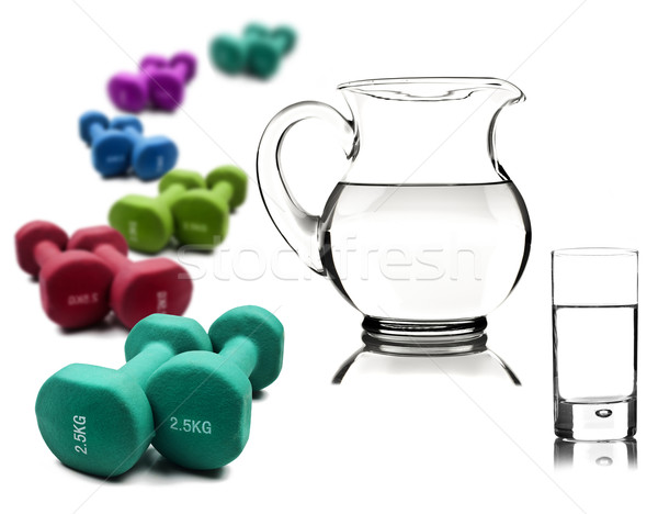 Healthy lifestyle - water in a pitcher and glass with dumbbells Stock photo © tish1
