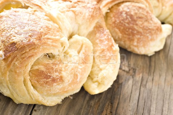 Close up of fresh croissants on a wooden surface Stock photo © tish1