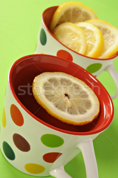 Tea with lemon in polka dot cups Stock photo © tish1