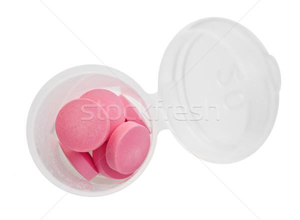 Rózsaszín tabletták tabletta üveg fehér űr Stock fotó © tish1