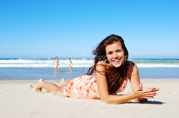 Young woman enjoying summer on the beach Stock photo © tish1