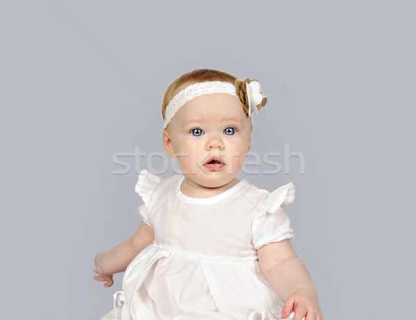 Beautiful little baby girl in a white dress Stock photo © tish1