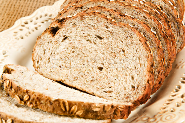 Healthy whole wheat bread in slices Stock photo © tish1