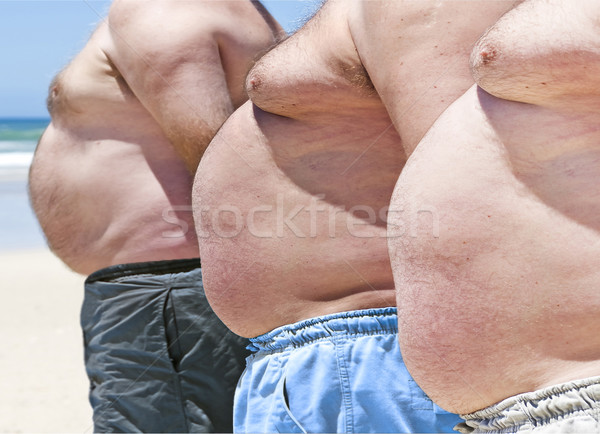 Close up of three obese fat men of the beach Stock photo © tish1