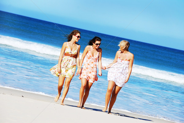 Stock photo: Three young woman having fun on the beach on a summer day