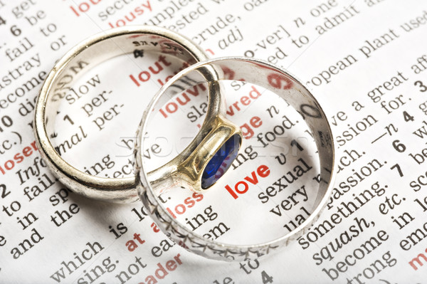 Wedding rings and the word love in dictionary Stock photo © tish1