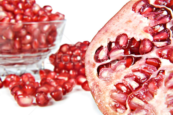 Pomegranate fruit and pipps Stock photo © tish1