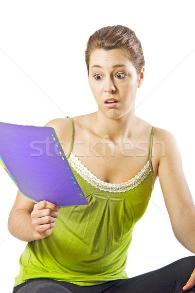 Beautiful young woman reading something shocking - white background with space for text Stock photo © tish1