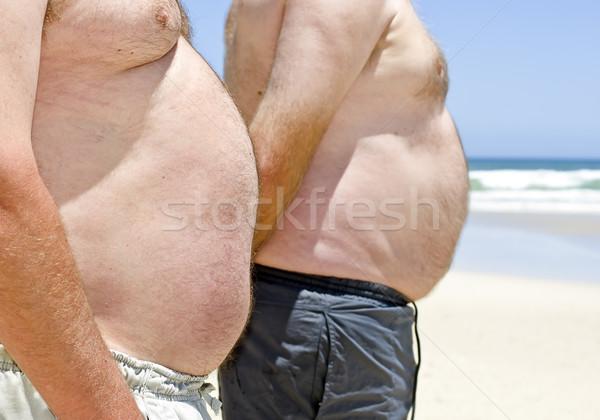 Dwa otyły tłuszczu mężczyzn plaży Zdjęcia stock © tish1