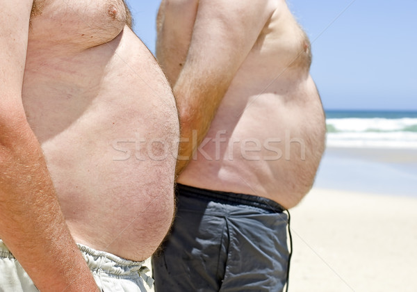 Dos obeso grasa hombres playa Foto stock © tish1